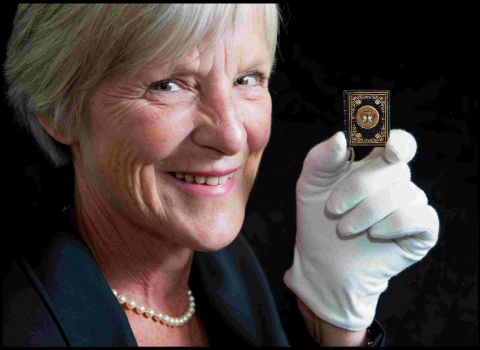 UNDER THE HAMMER: Deborah Doyle of Duke's with the tiny autograph book that includes the signature of the Queen