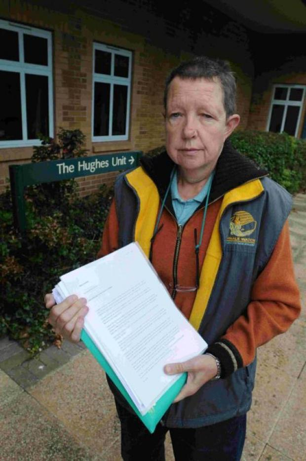 LEGAL BATTLE: Ros Copson outside the Hughes Unit with all her paperwork hoping for a judicial review