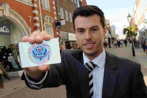 IT'S OUR GOAL: Matt Bradley in South Street with a Dorchester Affiliation Card