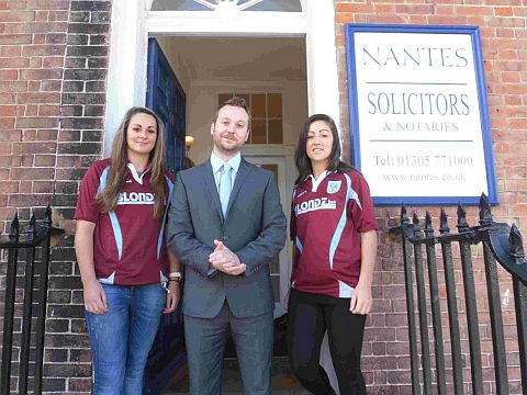 MATCH SPONSORS: Weymouth Ladies Georgia Rogers and Rosie Sharpe outside Nantes Solicitors