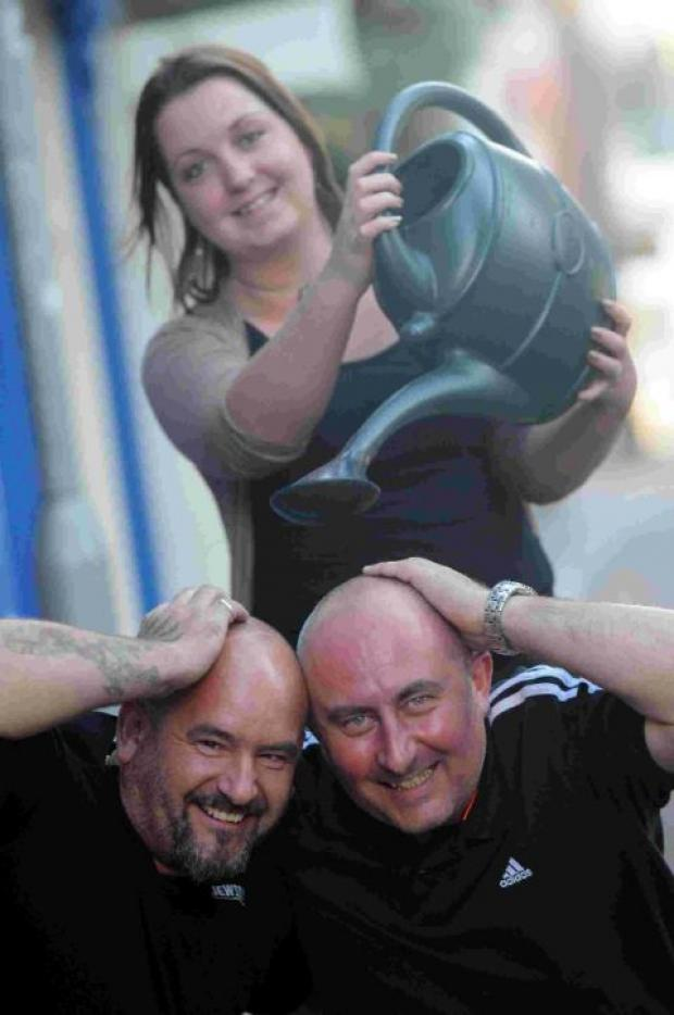 Dorset Echo: HAIR WE GO: Wayne Cross, left and Wayne Jordan get a little help from Martina Pitcher at the Market House