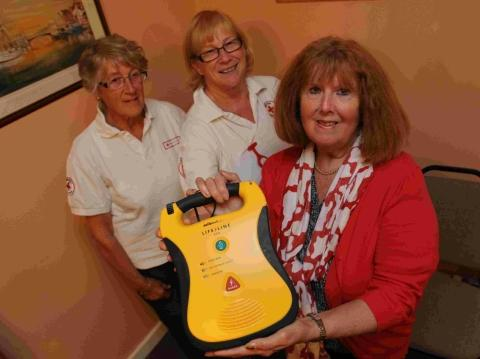 Former Dorchester Bowls Club president Sylvia Lawley, right, with members of the Red Cross Jenny Langdon, left, and Tina Davison and the defibrillator machine