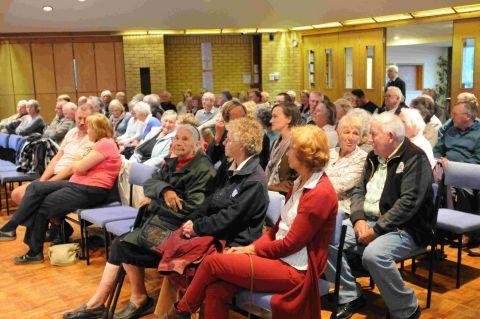 TALKING POINT: The packed meeting at Southill hears plans for  a new crossing on the A354 Weymouth Way    	JG8000
