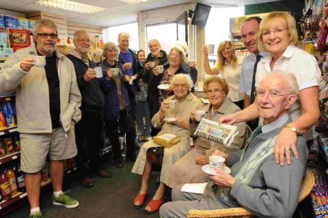 GOODBYE: Ronald Willsher's farewell party in the shop with owners Peter and Janet Blakey and fellow residents