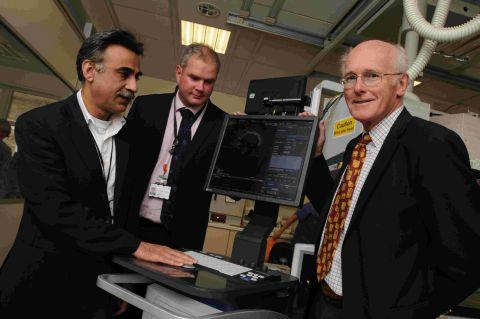 GOOD HEART:  Dr Peter Down, right, from Dorset Health Trust hands over the new piece of cardiology equipment to doctors Javed Iqbal and Fraser Witherow at Dorset County Hospital