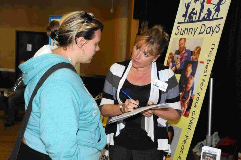 HERE TO HELP: SBS Training Centre's Joy Scadden taking details at a previous Echo Jobs Fair