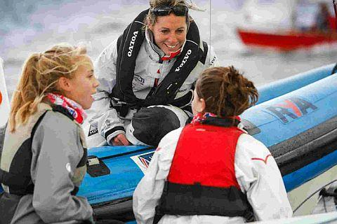 Dorset Echo: ANSWERING QUESTIONS: Paralympic gold medallist Helena Lucas with young sailors at the RYA South Zone Championships
