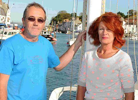 Dorset Echo: DOUBLE RESCUE: Deja catermaran crew Nigel Cresswell and Tina Cook arrive in Weymouth Harbour after their two rescues by coastguards and the RNLI