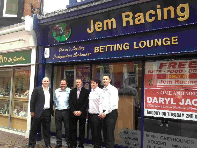 GRAND OPENING: Grand National winning jockey Daryl Jacob, centre, opens Jem Racing and is pictured with managing director Martin Johnstone, left, and staff