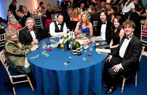 Guests enjoy a meal and entertainment at Upton House Walled Gardens