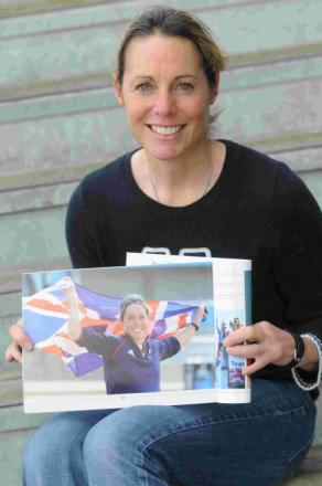 GOLD STANDARD: Paralympic sailing champion Helena Lucas with her copy of When the World came to Weymouth