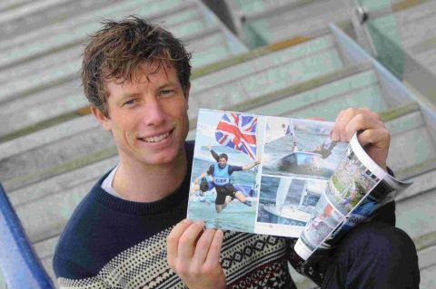 LOOK, IT'S ME: Olympic silver medallist Stuart Bithell with his copy of When The World came to Weymouth