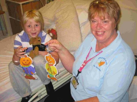 SMILE: Kingfisher Ward patient Alice Critchel with Play Specialist Julie Goodall
