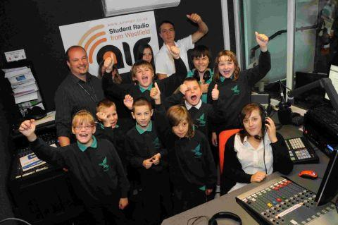 RADIO PLEA: Carl Greenham with pupils in the Westfield Arts College radio Air studio