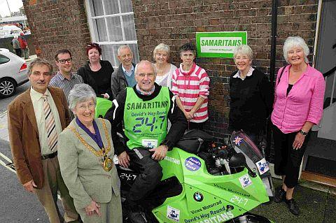 RIDING INTO TOWN: David Exley with mayor Margaret Leicester and volunteers at the Weymouth branch of the Samaritans