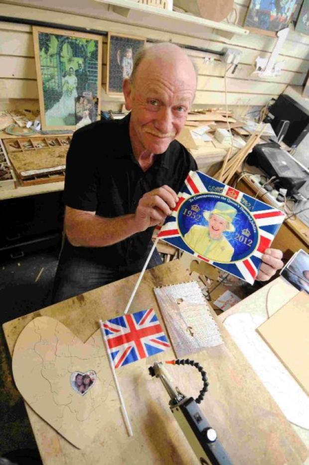PIECE WORK: Dave Evans who will make a jigsaw from Jubilee pictures