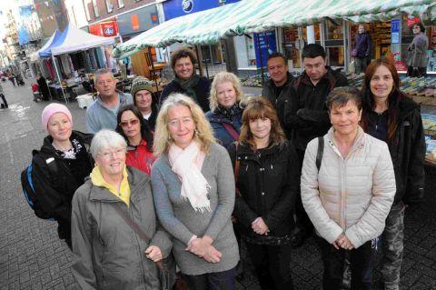 Dorset Echo: FORCED OUT: Market traders in South Street, Dorchester who are concerned at the potential closure by the council HG10069