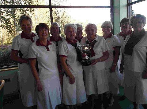 CHAMPIONS: Wellworthy Ladies collect the Division Two league trophy