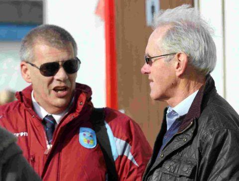 HELPING HAND: Chairman Nigel Biddlecombe talks to Stuart Morgan, right