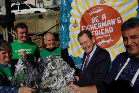 I'M A FISHERMAN'S FRIEND: MEP Sir Graham Watson, centre, with members of Be a Fisherman's Friend campaigners