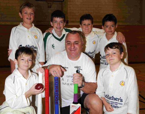 GRANT'S MISSION: Grant Neven, pictured with Portland Red Triangle youngsters, is embarking on a trip to Africa in aid of Cricket Without Boundaries