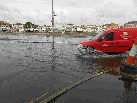 WATERLOGGED: The scene on Commercial Road in Weymouth