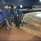 SOAKED: Chris Holder, Ludvig Lindgren and Neil Middleditch on track this evening