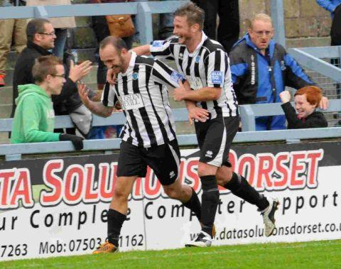CUP JOY: Ben Watson celebrates scoring the Magpies' third goal with Jamie Gleeson