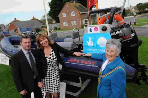 Dorset Echo: MARK OF RESPECT: David and Sally Wright with Weymouth and Portland Mayor Margaret Leicester at the unveiling of the rib named after Marine James Wright,