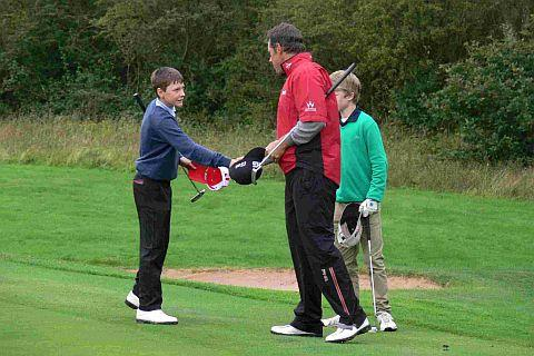 Dorset Echo: HANDY SCORE: Adam Harris shakes hands with Ryder Cup ace Lee Westwood