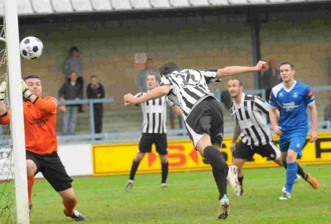 HEAD FIRST: Nick Crittenden scores the Magpies' second goal in their FA Cup victory over Bury on Saturday