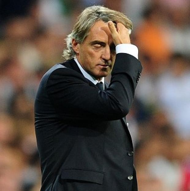 Dorset Echo: Roberto Mancini took responsibility for Manchester City's defeat at Ajax.