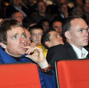 Bradley Wiggins, left, and Chris Froome look on during the 2013 Tour de France Presentation in Paris
