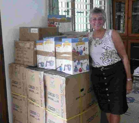 GLOBAL GIRL: Brenda Banbury with equipment to be delivered to the clinics