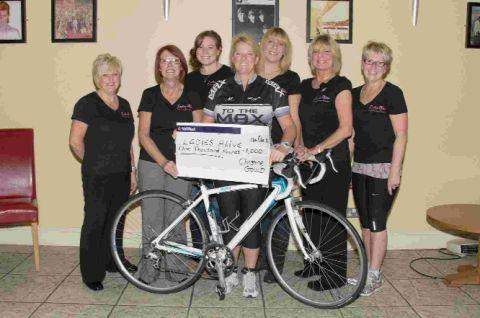 PEDAL POWER: Christine Gould, centre, presents money to Ladies Alive after her training challenge. From left, Debbie Pollard, Georgina Grayson, Laura Stone, Alison Wilcocks, Susan-Jane Smith and Jo Shorey