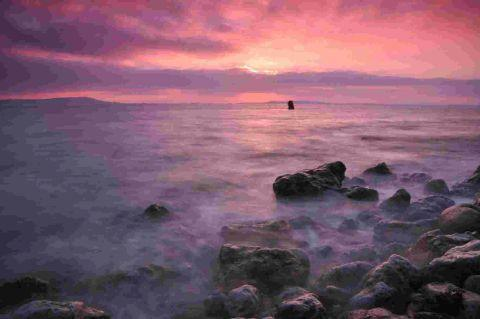 SUNSET STRIP: Mark Andre's photograph of sunset at Osmington Mills is just one of the fabulous images in the book Dorset: A Photographic Journey in an Olympic Year
