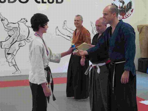 TOP STUDENT: Sensei Fred Burnham presenting Matthew Maton with the overall winners' trophy, while Sensei Nick Maton and Shihan Kevin King look on