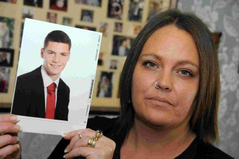 Pauline McNulty with a photo of her son Brendan, who is on a school trip to the United States and had his travel plans disrupted by Superstorm Sandy