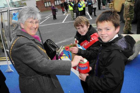 APPEAL LAUNCH: Mayor Margaret Leicester buys a poppy from Conifers Primary School pupils Cameron Paul and Joshua Caswell-Wills