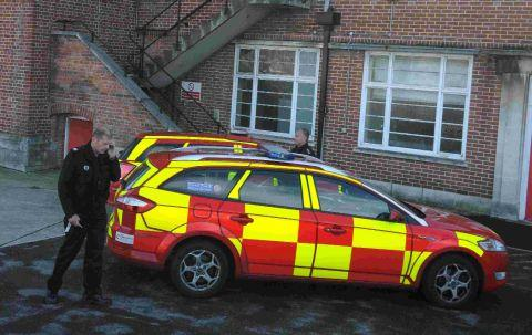 TRAGEDY: Police and fire officers at the former fire station in Weymouth