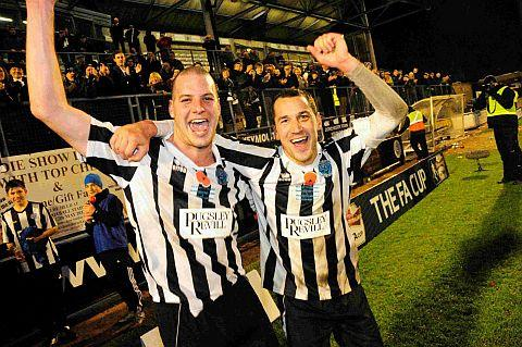 HAVING A BALL: Nathan Walker and Mark Jermyn celebrate the Magpies' FA Cup victory over Plymouth