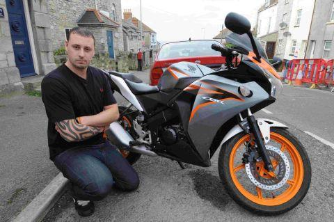 FED-UP: Sam Johnson with his stolen motorcycle on Portland and, inset, the damage thieves did to the machine