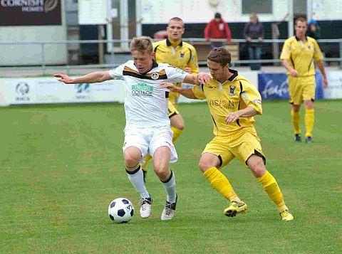 Dorset Echo: TALENTED: Defender Dan Green, left, is closed down by former Magpie and Terra James Coutts