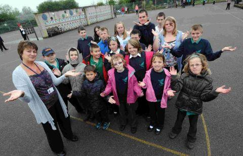 HOPEFUL: Jenny Savage and Westfield pupils with their playground