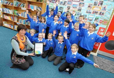 WELL DONE: Teacher Kimberley Dukes with pupils at St John's Primary
