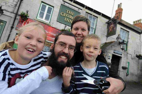 IN TRIM: Anthony Storey loses his year-long Movember beard with wife Tracey and children Sophie and Oliver
