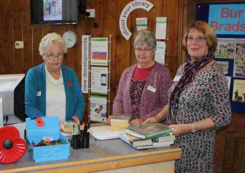 READ ALL ABOUT IT: Volunteers Maureen Miller, Gillian Perkins and Rosemary Daniels at Burton Bradstock Library