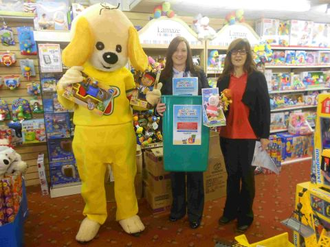 MASTERSTROKE: Helen Honebon of Howley's Toymaster with Echo promotions manager Debbie Hellaby and Toby the Toymaster dog