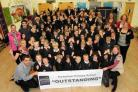 DIDN'T WE DO WELL?: Pupils and teachers at Portesham Primary School celebrate an outstanding OFSTED report