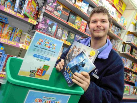 GENEROUS: James Buckley at WH Smith in Weymouth, on a quest to help the Echo's toy appeal